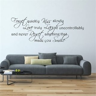 En Wallstickers med teksten Made you smile!