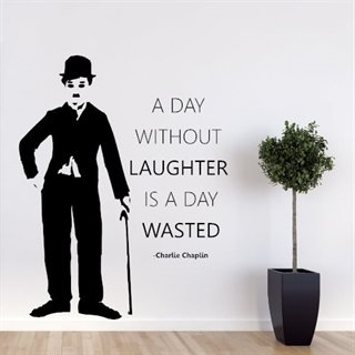 Wallstickers med tekst a day without laughter